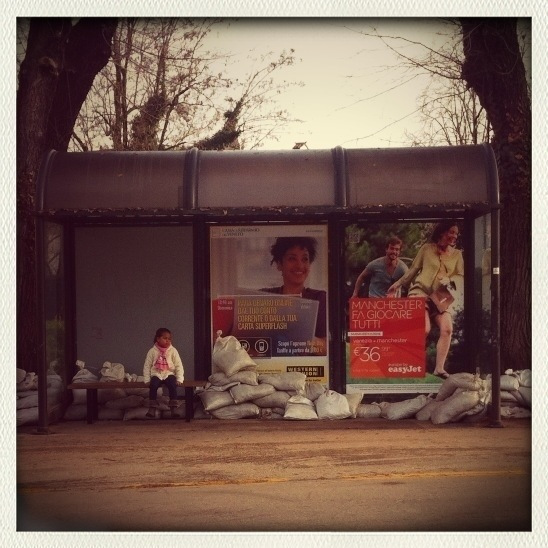 little girl alone in a bus stop